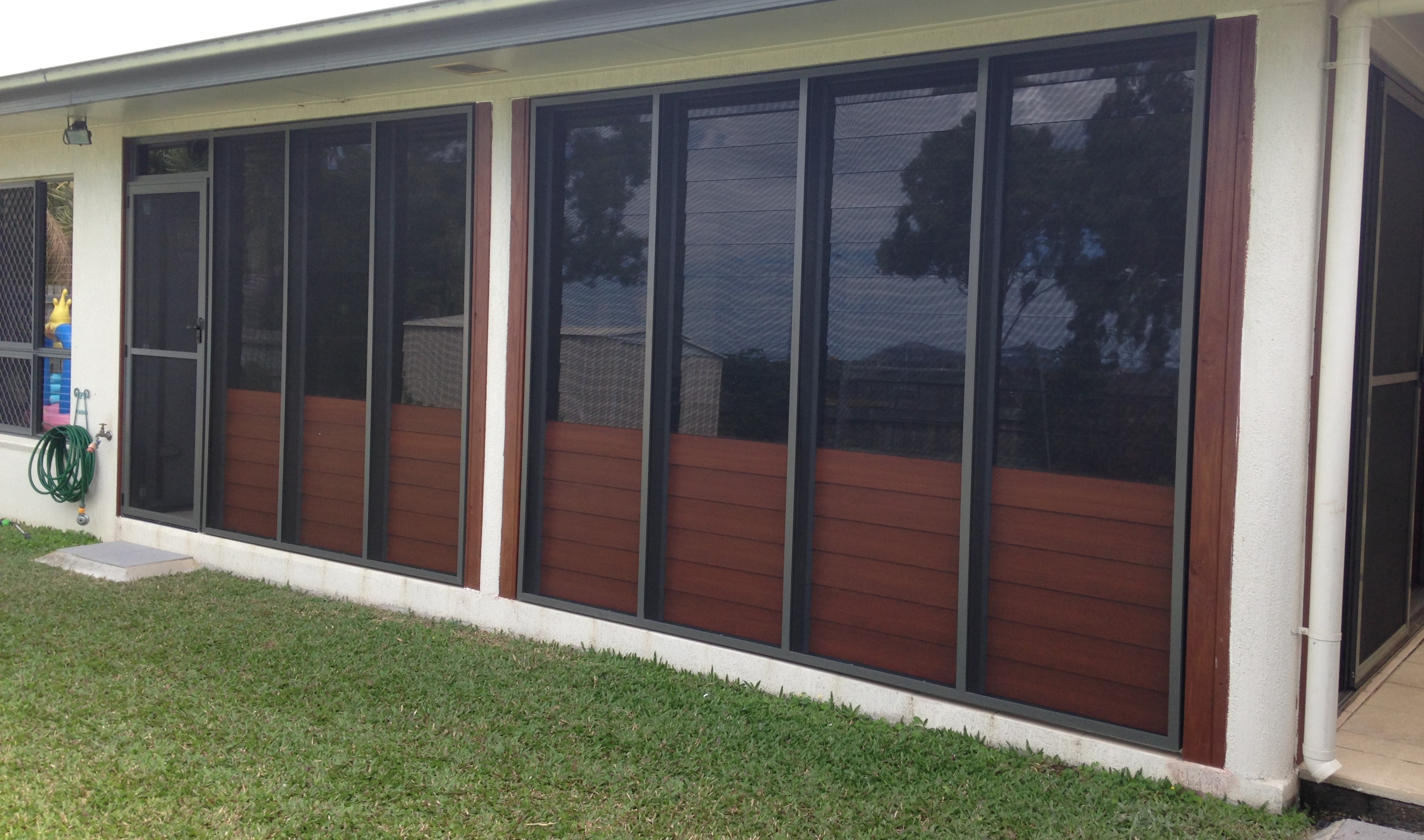 After - Glass Louvres To Top - Timber Look Louvres To Bottom